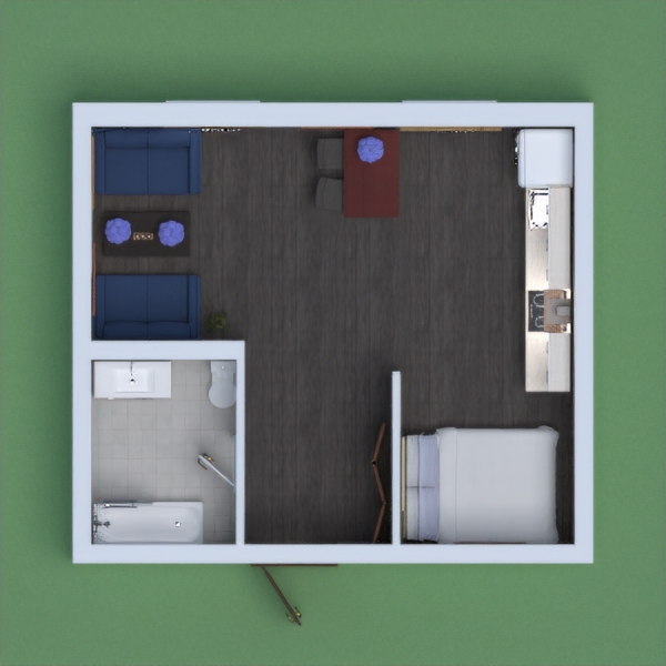 A apartment  with a bathroom, kitchen, living space, and a bedroom.